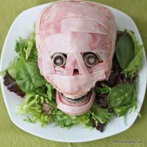Fake skull wrapped in ham - meat head
