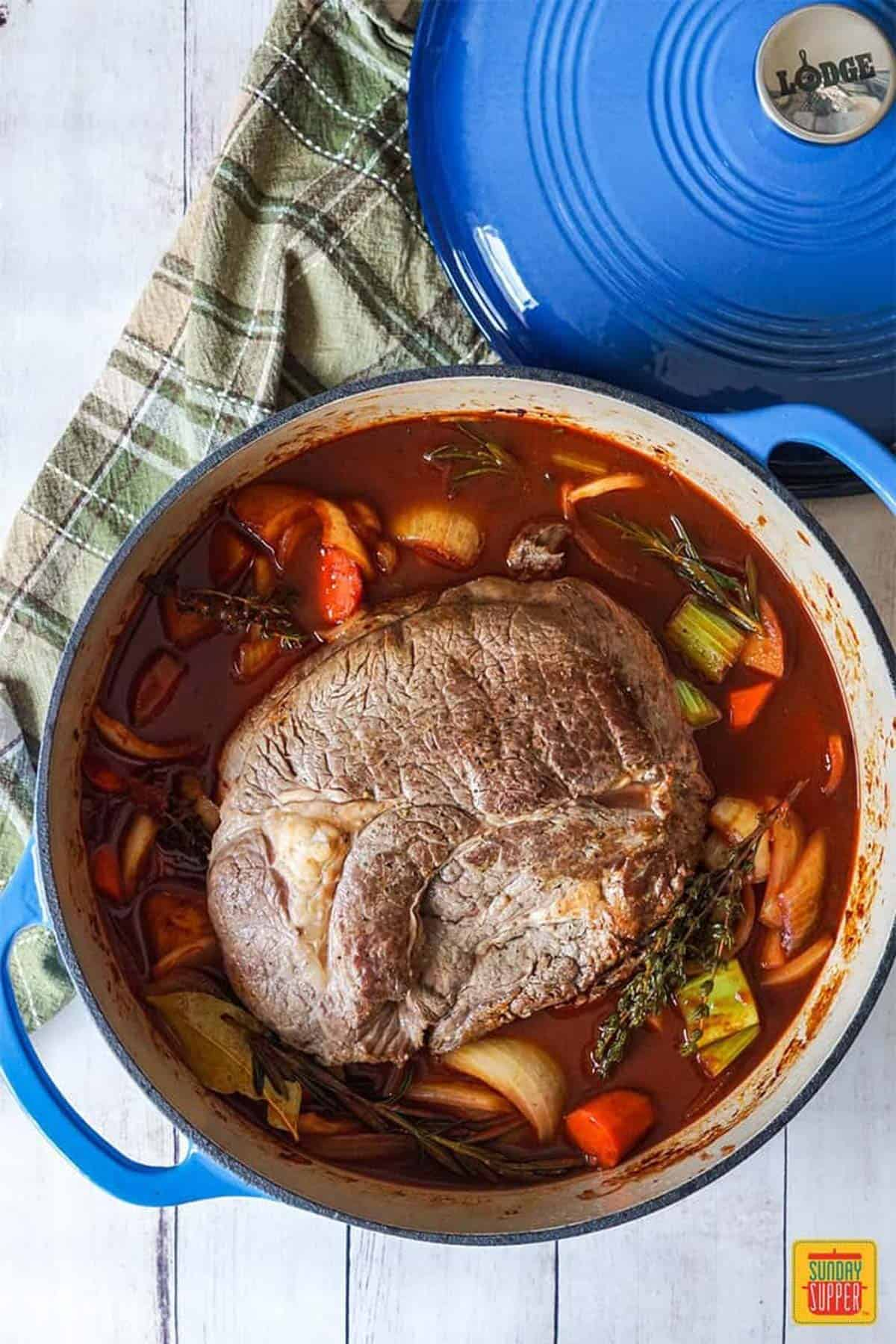 Beef chuck roast in the dutch oven with vegetables