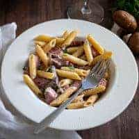 Creamy Penne Pasta with Sliced Prime Rib - restaurant style meal served on a plate