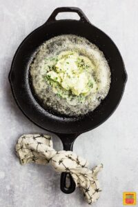 Melting garlic butter in a skillet