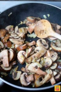cooking the mushrooms for creamy leftover prime rib pasta