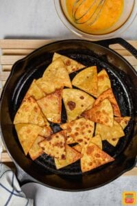 tortillas fried in a cast iron pan