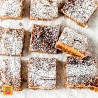 nine milk bar pie squares on white parchment paper