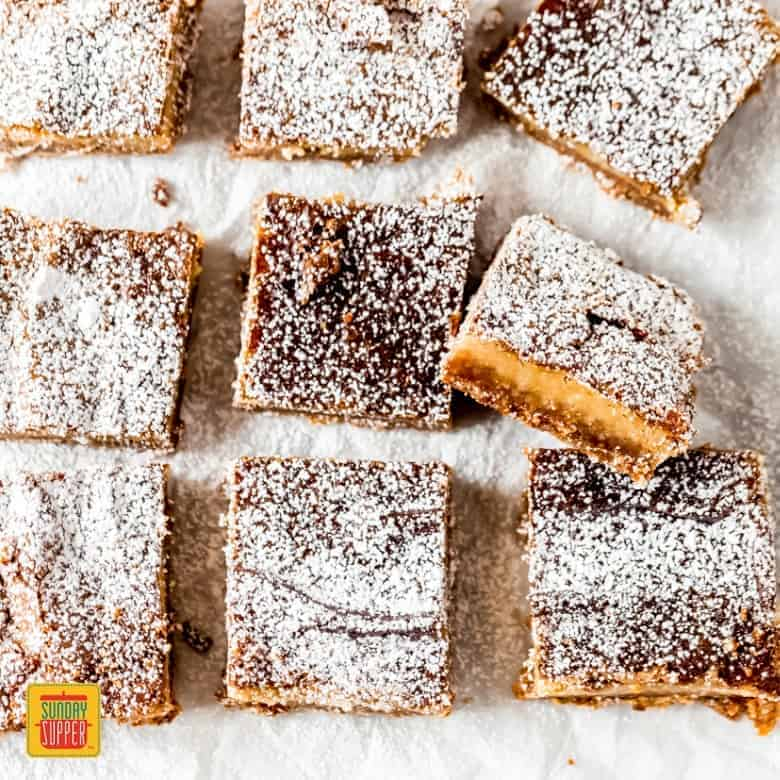 nine milk bar pie squares on white parchment paper
