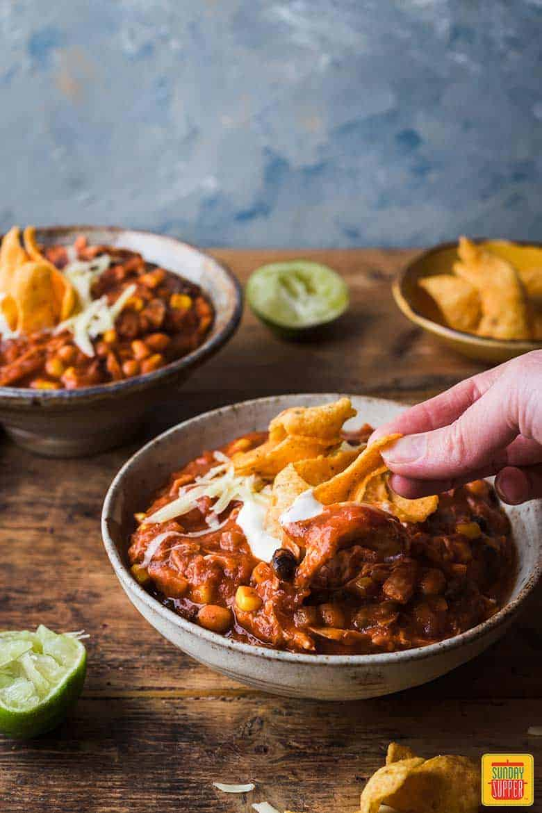 Topping the best chicken chili recipe with frito chips