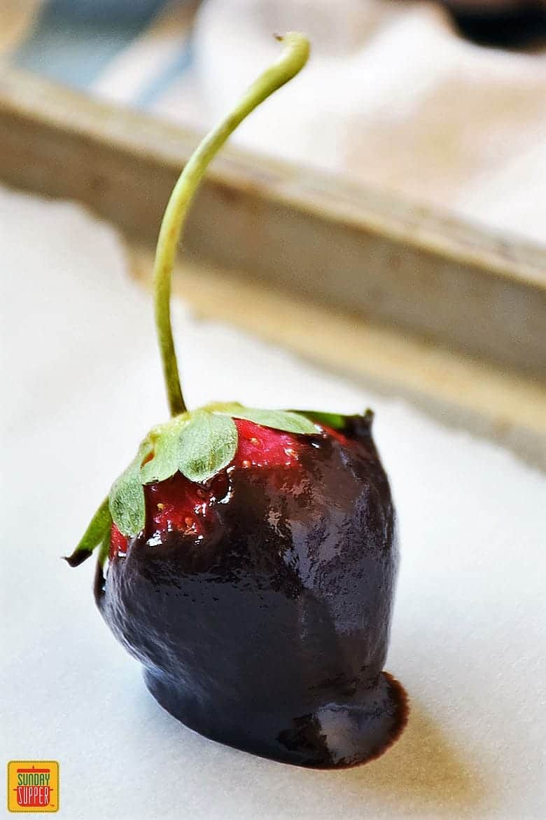A single ganache dipped strawberry for how to make ganache