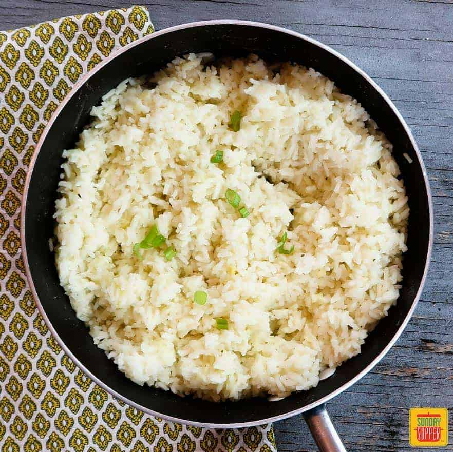 How to cook perfect rice: rice in a pan with green onions