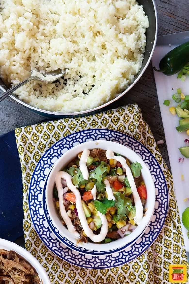 How to cook perfect rice: rice in a bowl with pulled pork and veggies on top