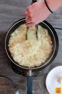 Removing the onion from the rice