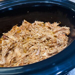Pulled pork in a slow cooker close up