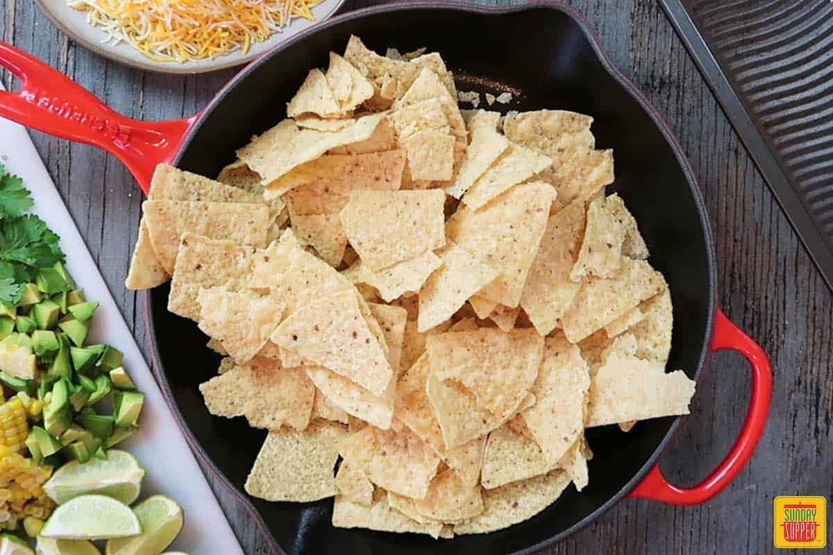 Nacho chips in skillet for Pulled pork nachos