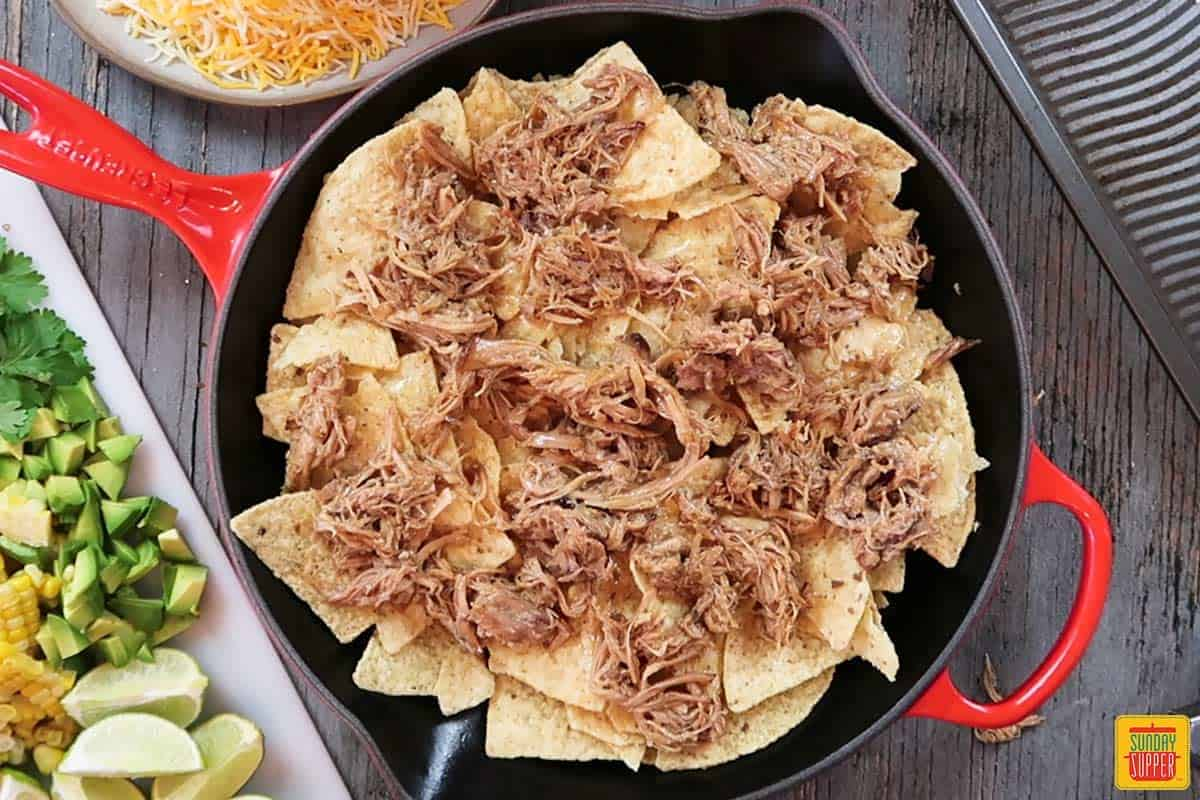 Adding pork to pulled pork nachos