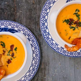 Two bowls of Shrimp Bisque Recipe on white and blue floral plates