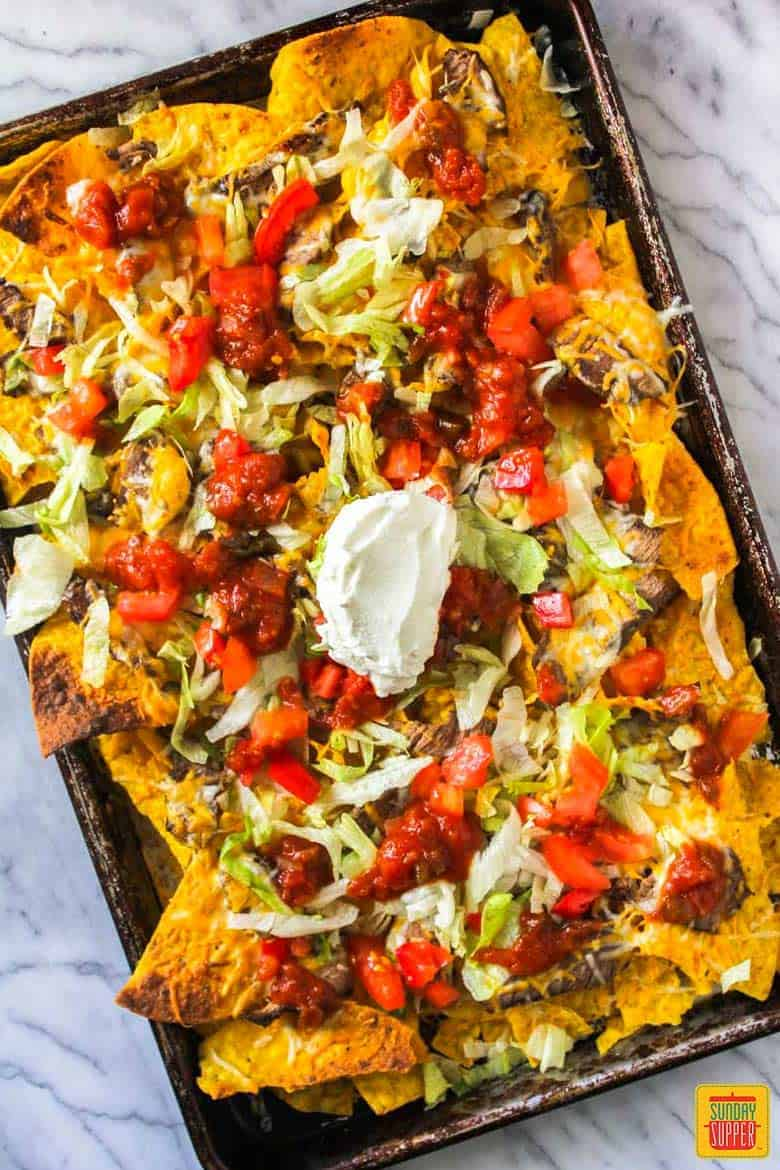 Baked nachos on a sheet pan with steak