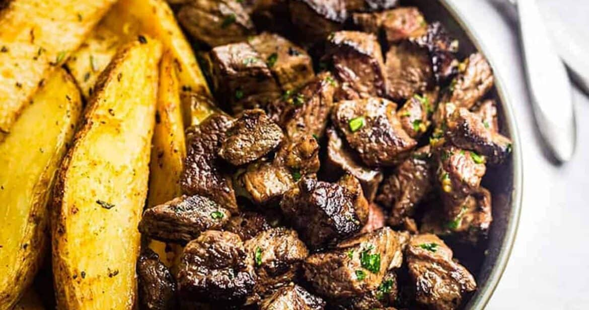 Steak Side Dishes - Juicy garlic butter steak bites with baked crispy potato wedges