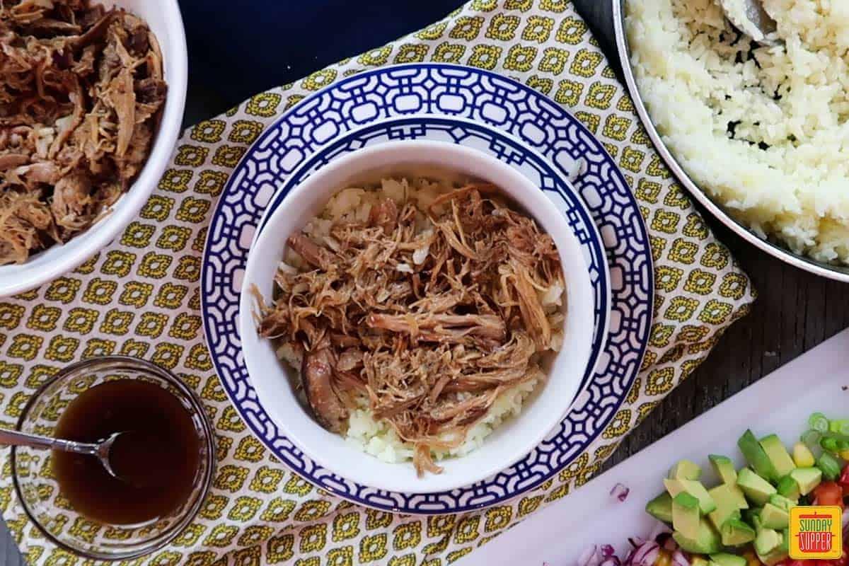 Adding pork to rice bowl