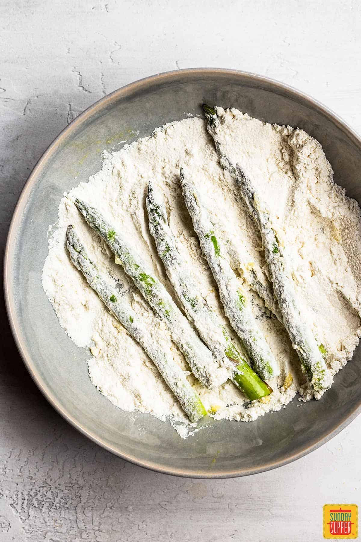 Coating asparagus in flour for air fryer asparagus