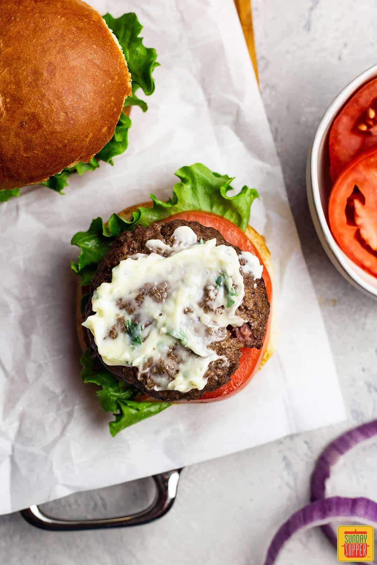 Open face air fryer burger with garlic butter spread
