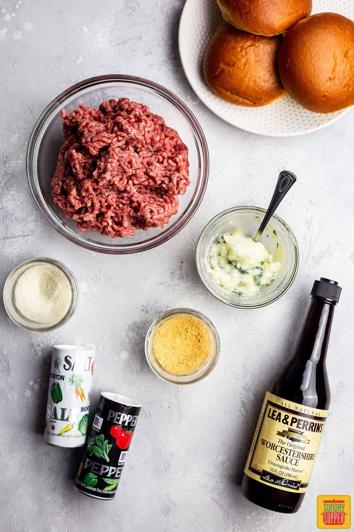 Ingredients to make an air fryer hamburger laid out on the counter