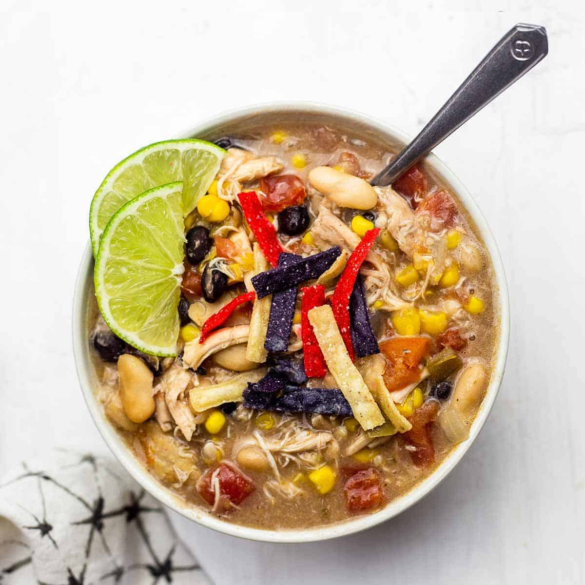 A single bowl of chick-fil-a chicken tortilla soup with a spoon