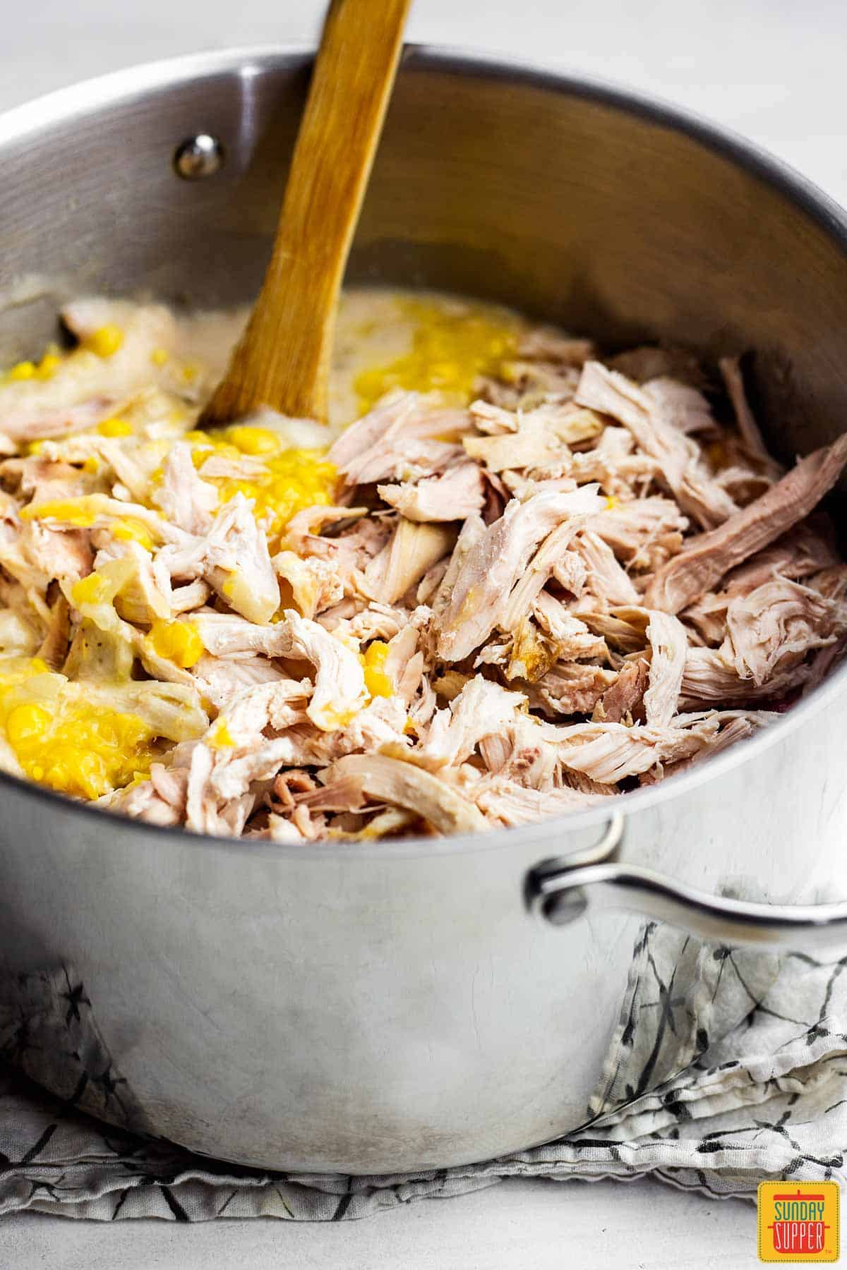 Close up of the chicken and corn in the pot for chicken tortilla soup recipe