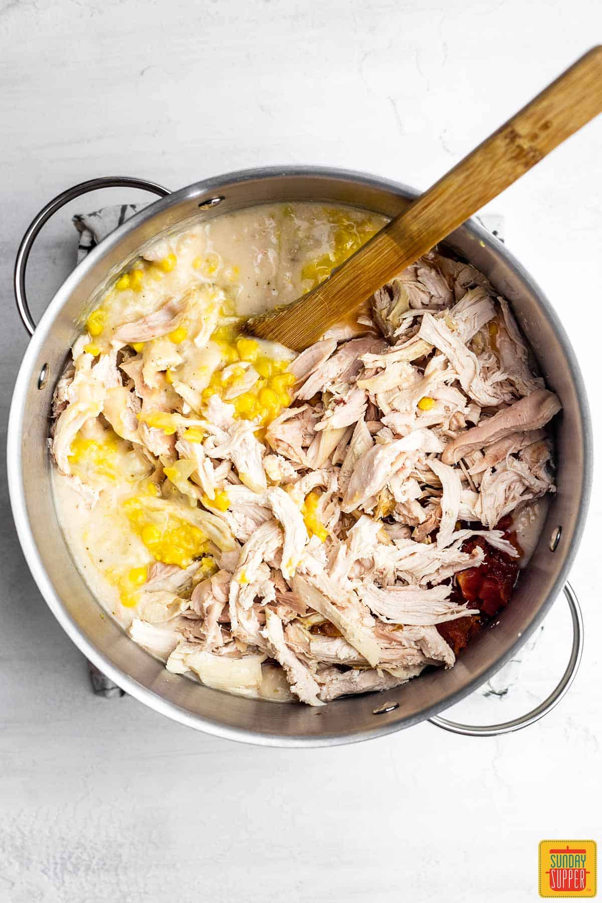 Shredded chicken in the pot for chick-fil-a chicken tortilla soup