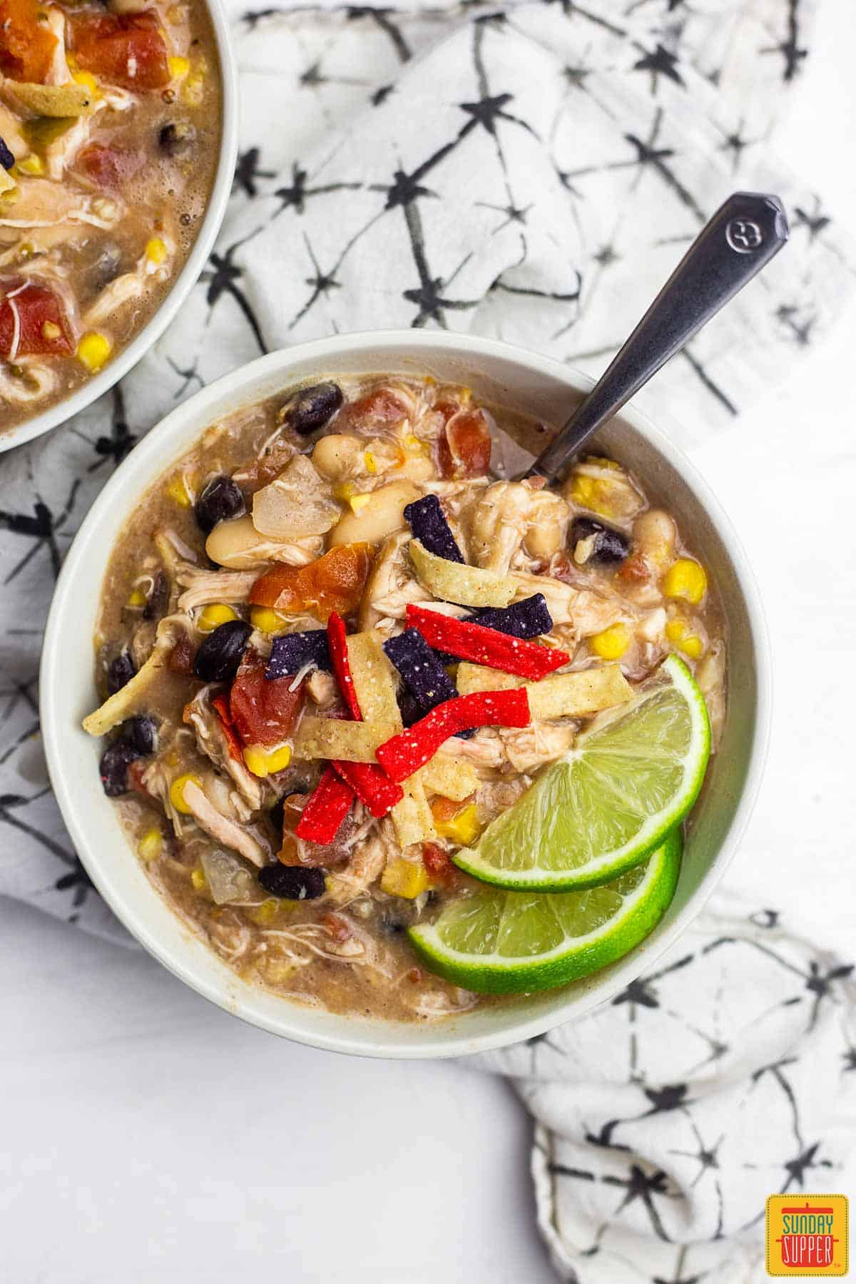 A bowl of chick-fil-a chicken tortilla soup with fresh lime slices