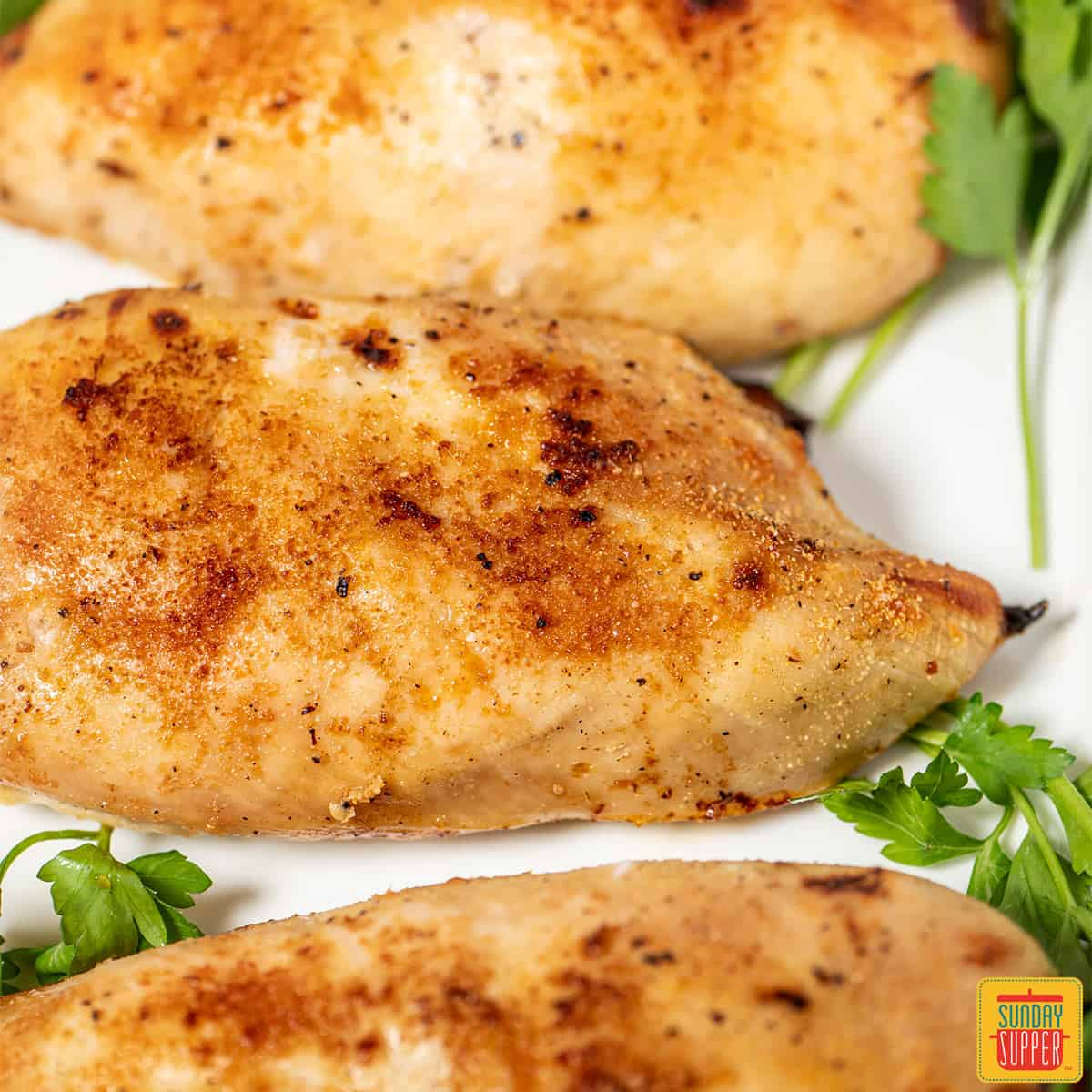 Three buttermilk roast chicken breasts close up