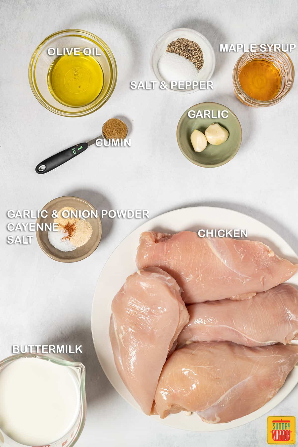 Ingredients to make buttermilk roast chicken with labels
