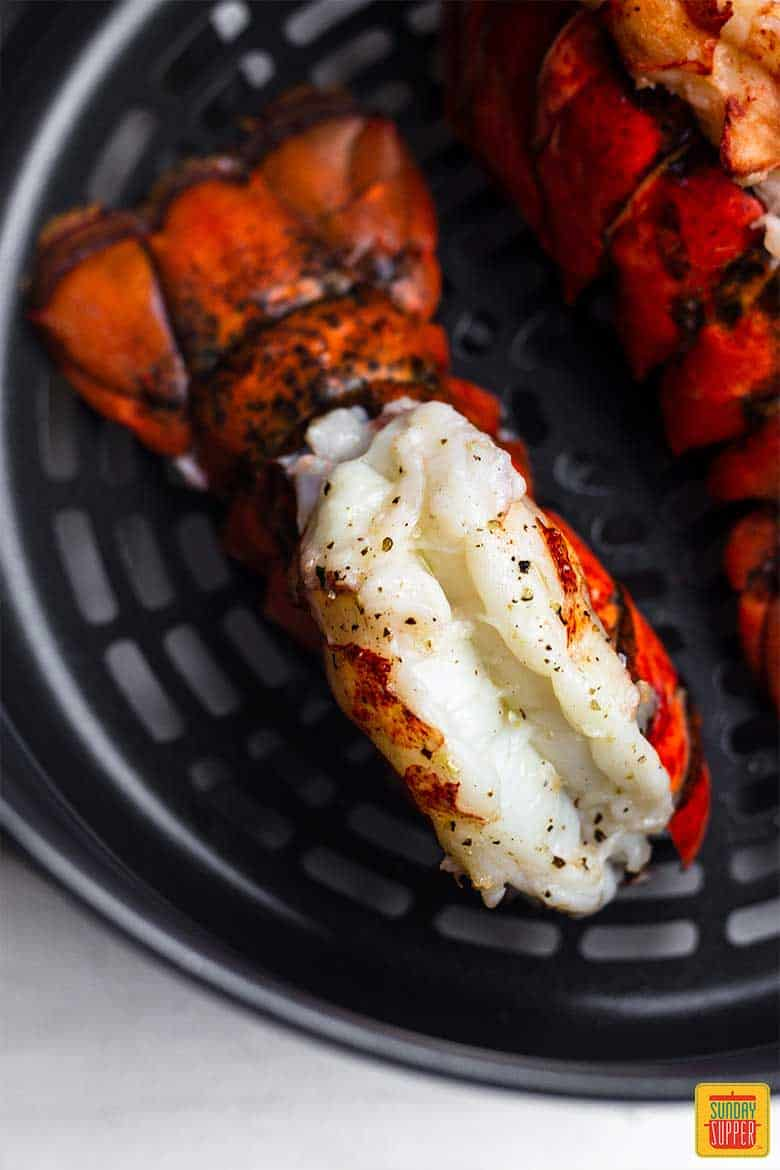 Fried lobster tails fresh out of air fryer for surf and turf recipe