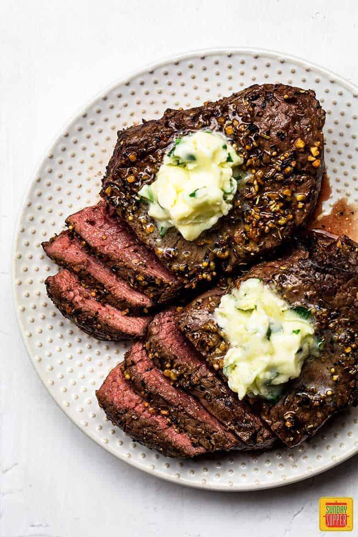 Air fried steak on a white plate