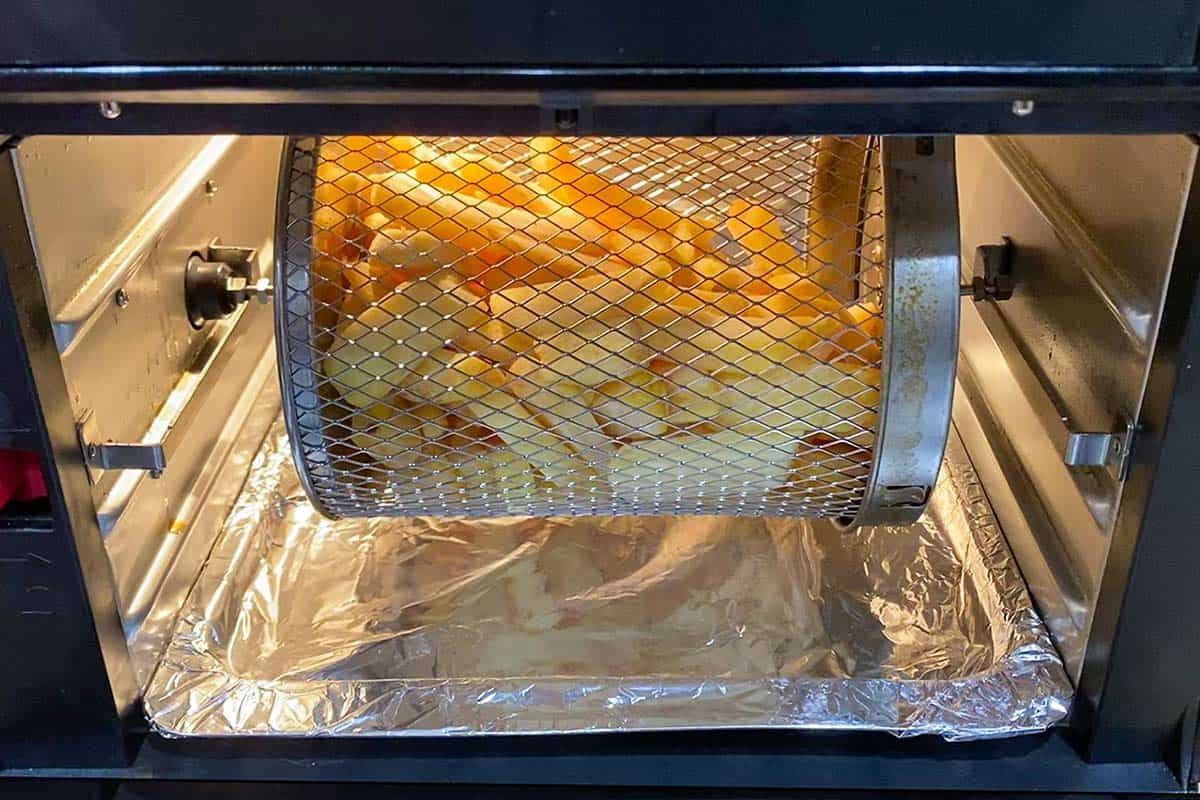 Frozen french fries cooking in the air fryer