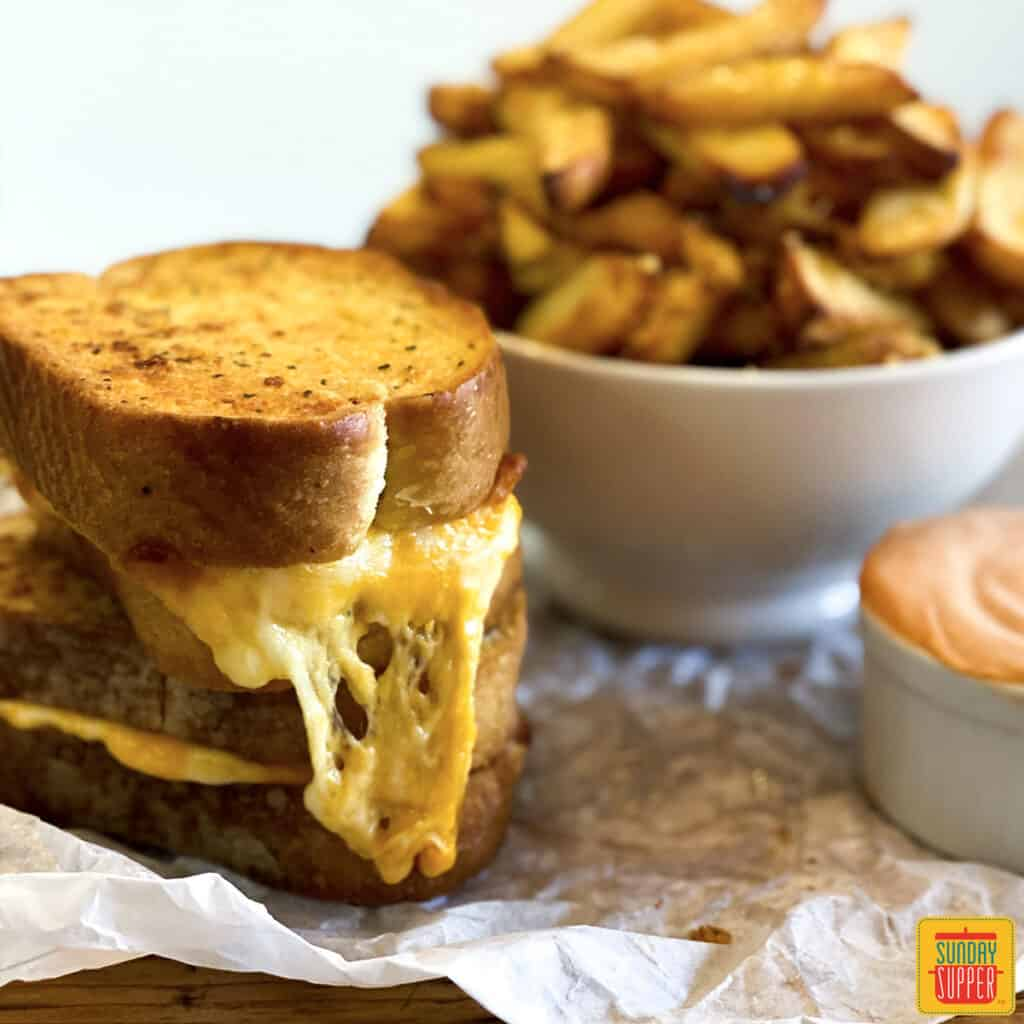 Air fryer grilled cheese sand a bowl of air fryer frozen french fries