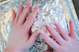Covering the ham in foil