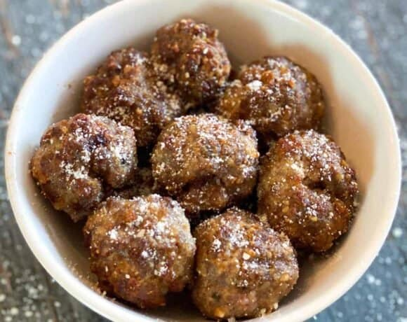 Eight meatballs in a white bowl