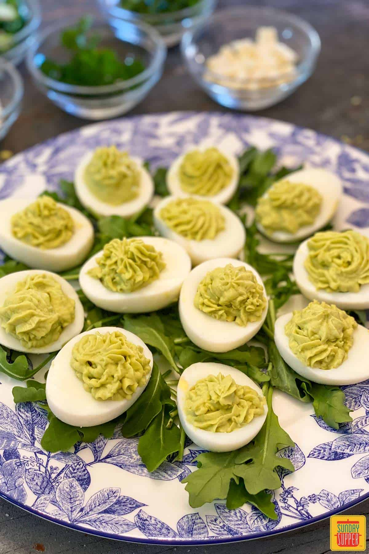 Close up of avocado deviled eggs with plain filling