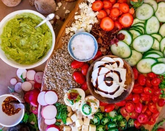 Avocado toast toppings bar with a platter of toppings and avocado spread