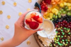 Strawberries on top of yogurt parfait in cup