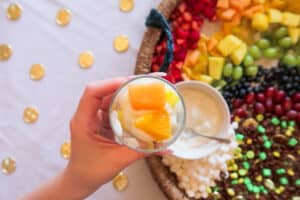 Cantaloupe and orange slices on fruit and yogurt parfait