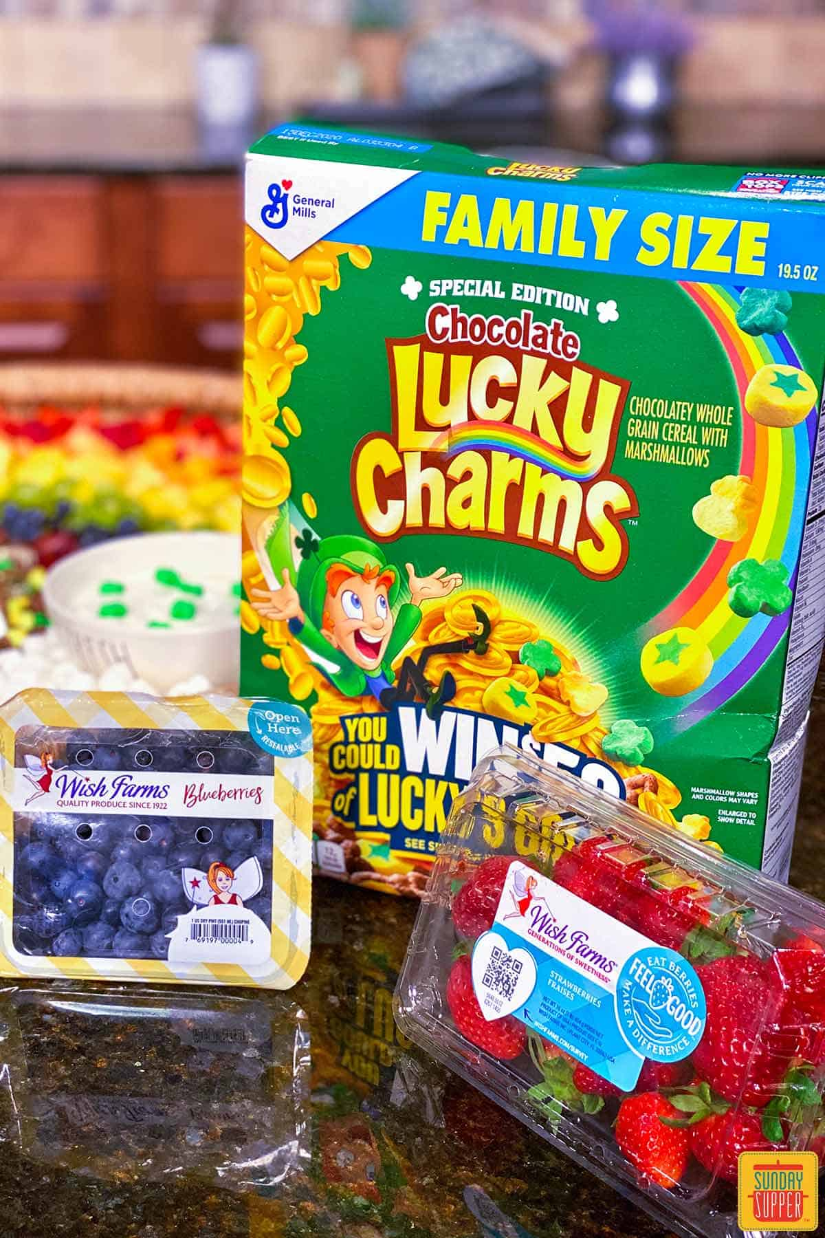 Lucky charms and fresh berries for fruit and yogurt parfait bar