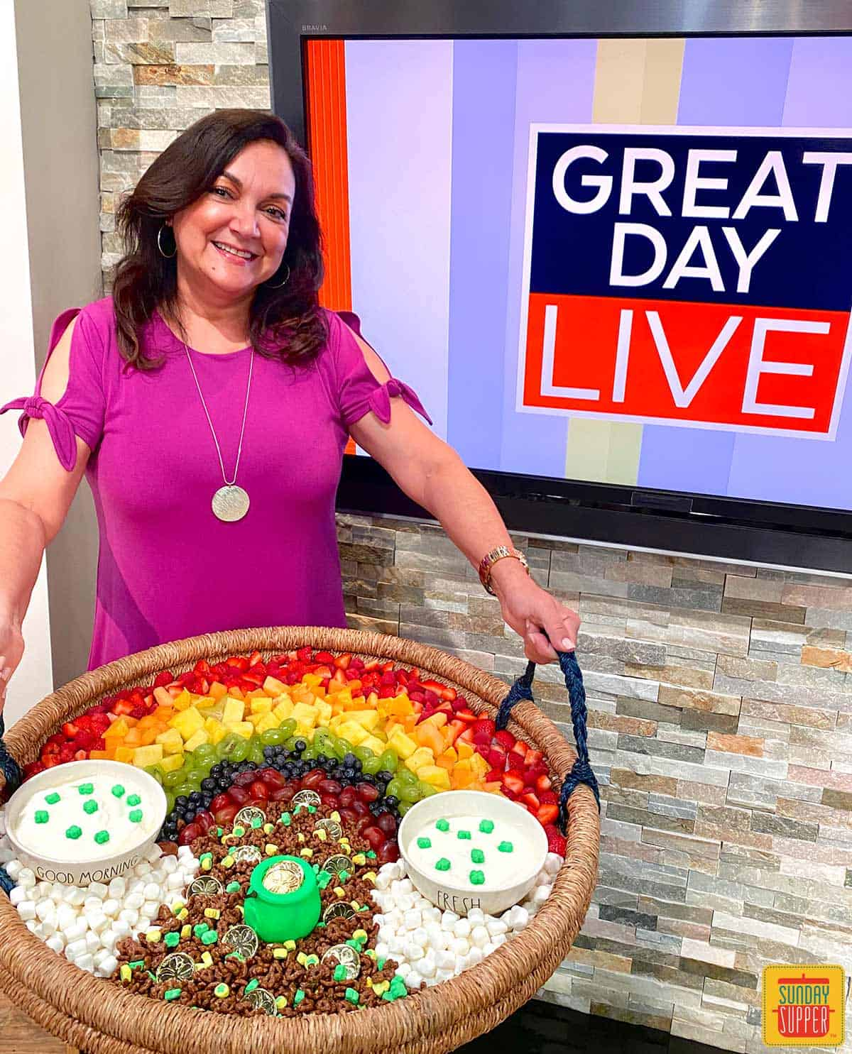 Isabel, Family Foodie, holding the fruit and yogurt parfait bar tray in front of the Great Day Live Tampa Bay set
