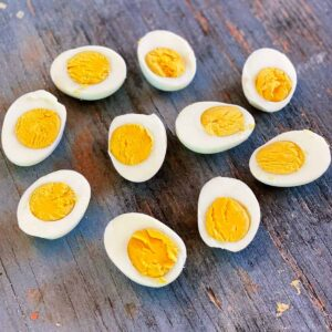 Instant pot hard boiled eggs on a wooden board