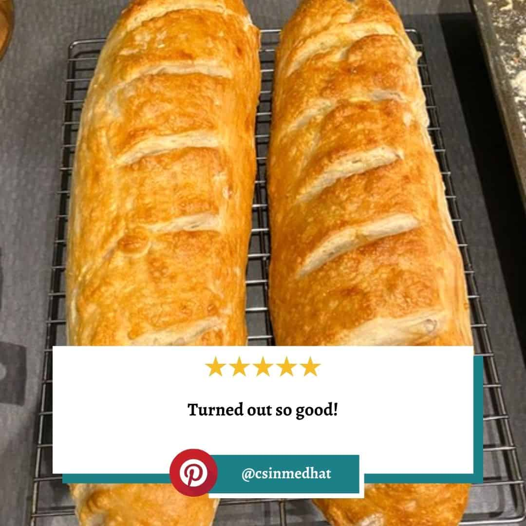"""Reviewer photo of two loaves of french bread with a 5 star rating and the text """"Turned out so good!"""" with their Pinterest username, @csinmedhat"""