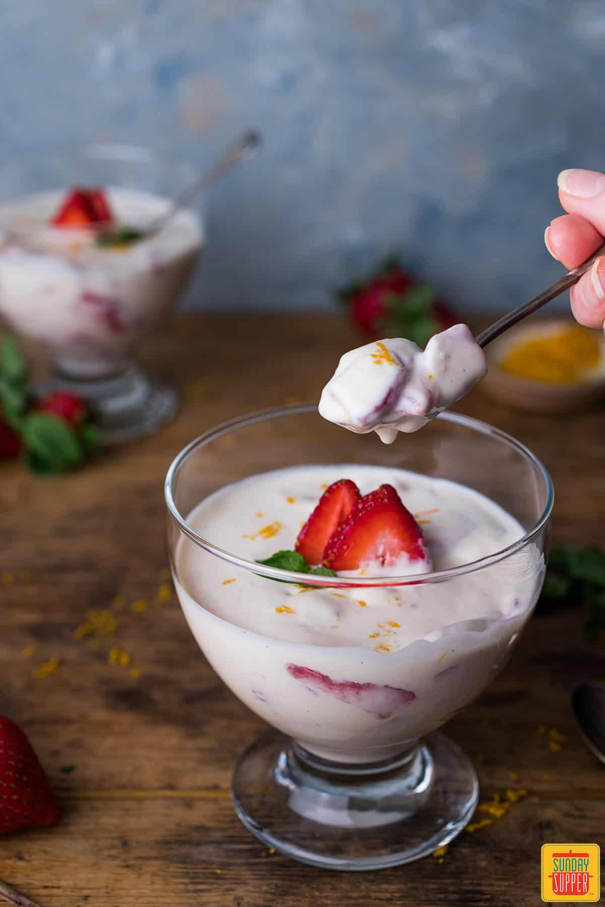 Two bowls of fresh Mexican strawberries and cream