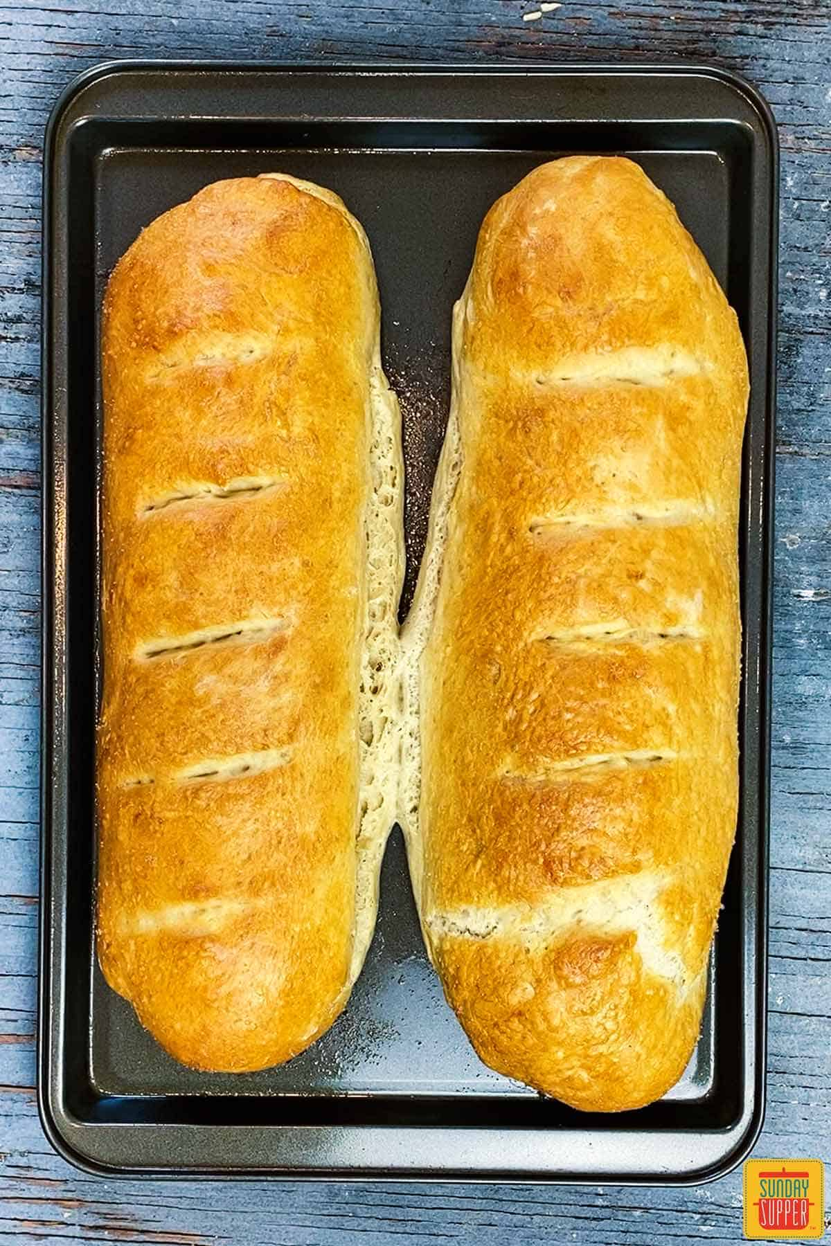 After baking homemade french bread recipe - two loaves on a baking sheet