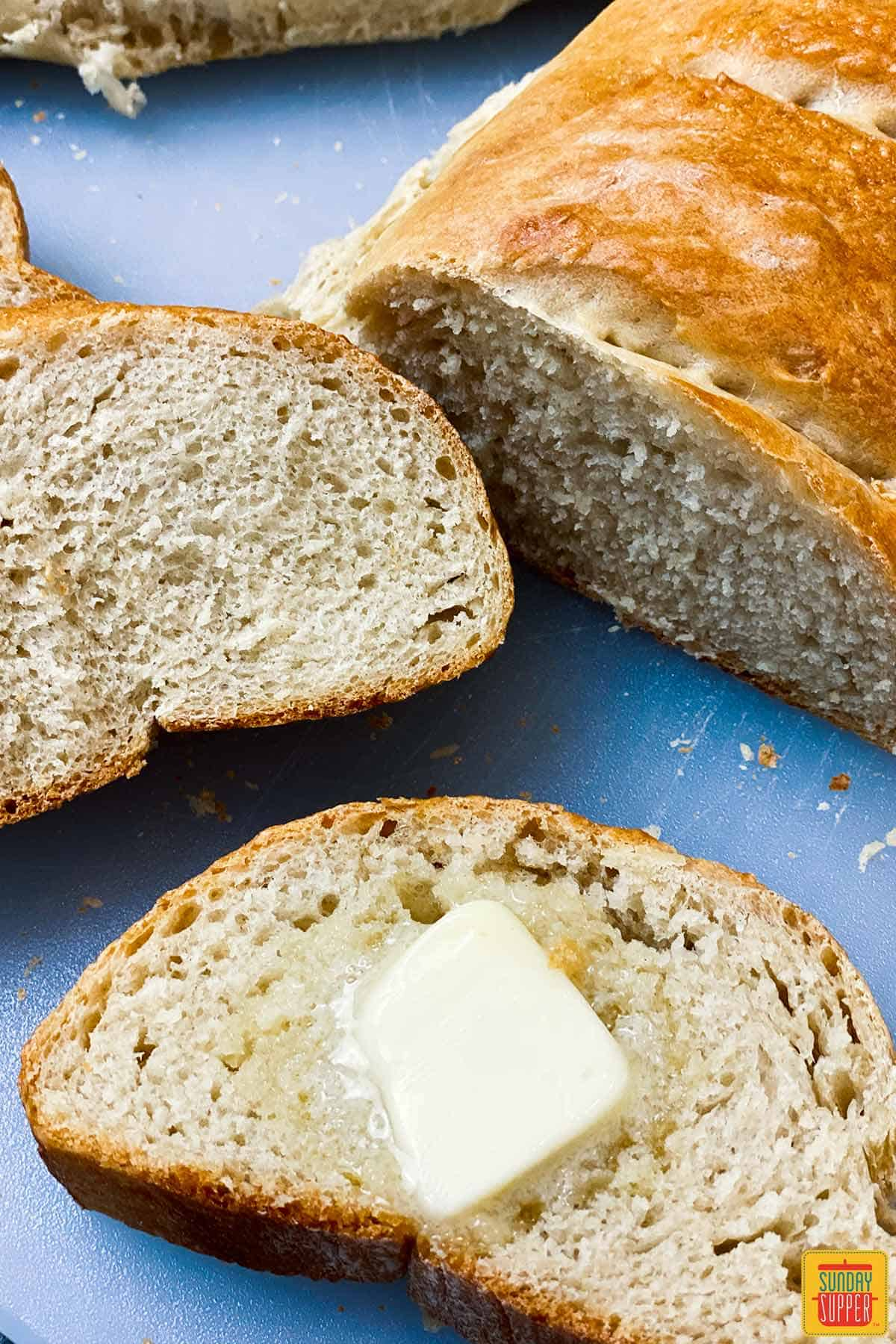 How to make french bread - Slices of homemade french bread with butter