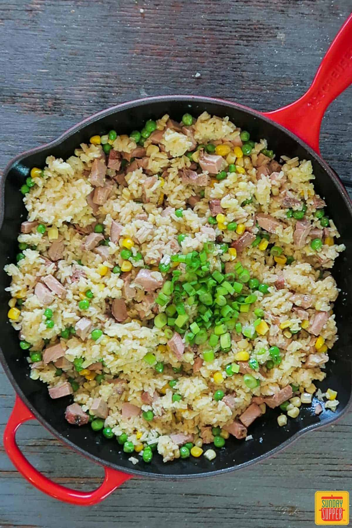 Adding green onions to fried rice