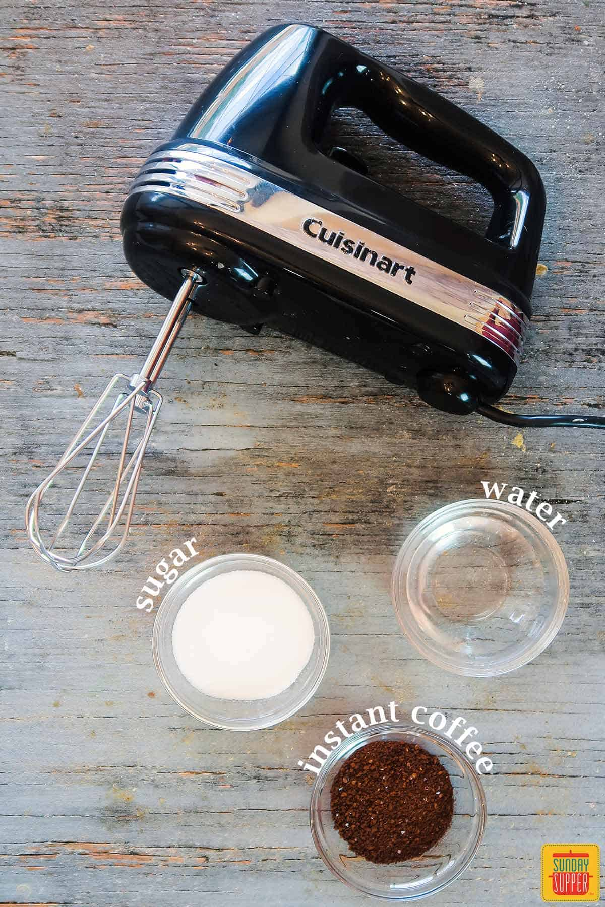 Ingredients for whipped coffee and electric mixer