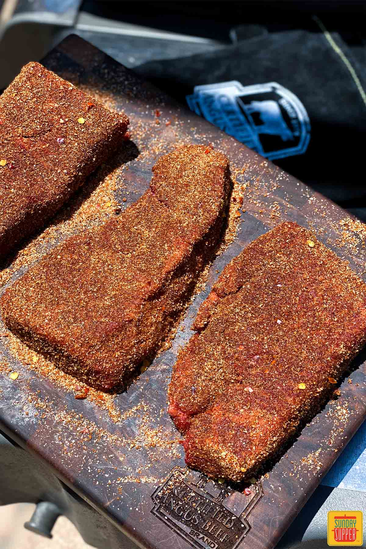 Beef short ribs coated in seasoning and ready to grill