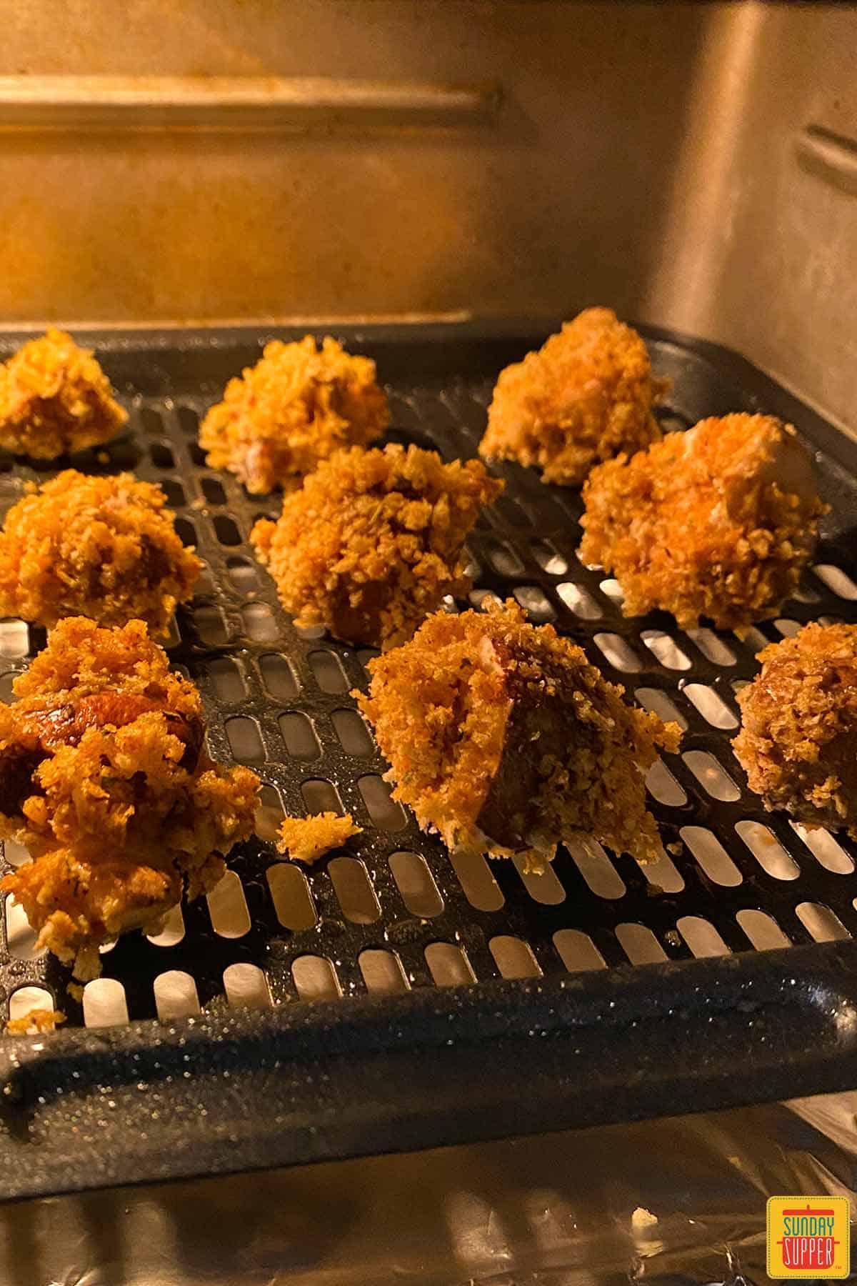 Air fryer mushrooms in the fryer on a rack